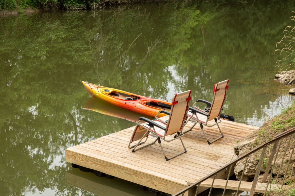 A small dock with a canoe at the ready.